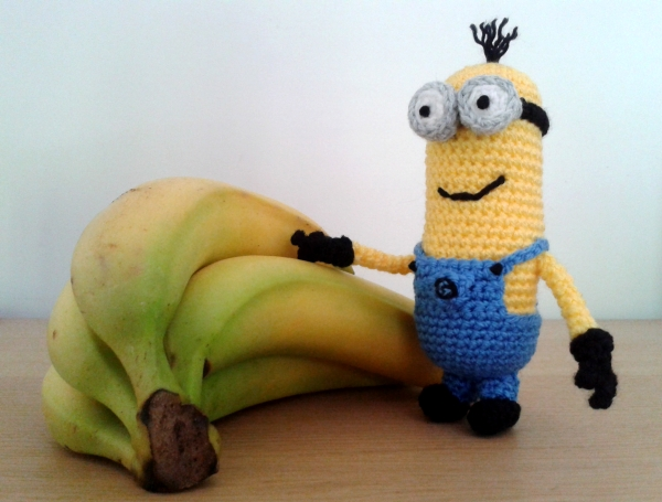 Kevin the crochet minion with a bunch of bananas