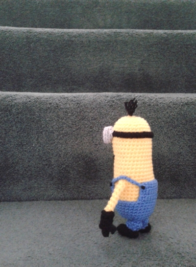 Kevin the crochet minion looking at stairs