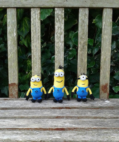 Crochet minions on a bench