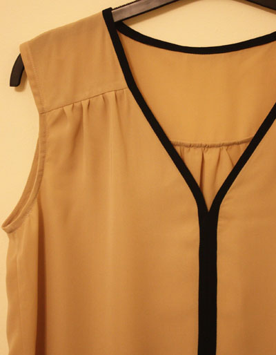 Beige V neck top contrast trim detail