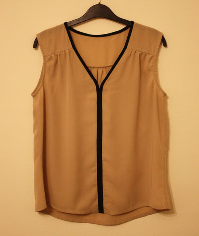 Beige V neck top with gathers and contrast navy blue trim