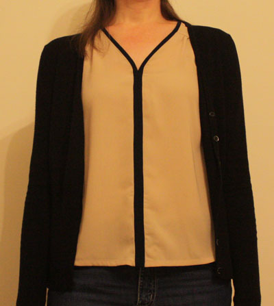 Beige V neck top worn with cardigan