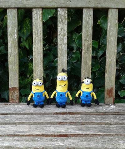 Crochet minions on a bench