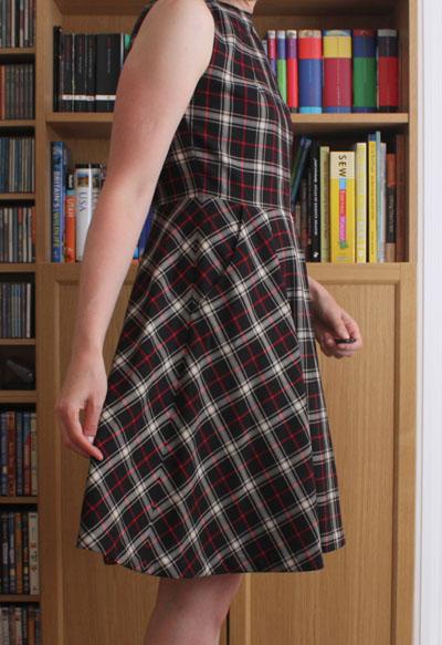 Neck pleat dress side